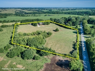 GONE! 8-Acre Country Estate with 2 Bedroom Home, 4-Garages, Outbuilding and Pond | Unincorporated Clay County, Liberty, Missouri