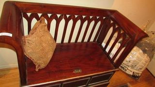 Unusual carved wood bench with storage s