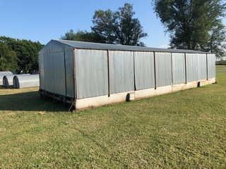 Luco portable Farrowing building on skid, 8-crates, electric, lighted, and new heater, 12'x40'