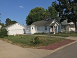 SPACIOUS HOME AND LARGE GARAGE ON .26 ACRE LOT