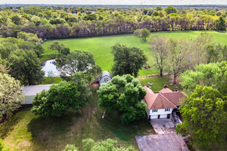 SOLD! Updated 4 Bedroom Home, 5-Acres, Outbuildings, Pond | Raymore, Missouri