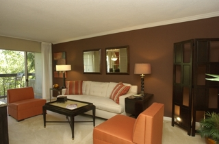 Chic and comfortable living room of one of the model units included in the auction