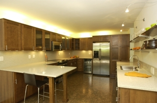 Urban-styled kitchen in one of the model units included in the auction